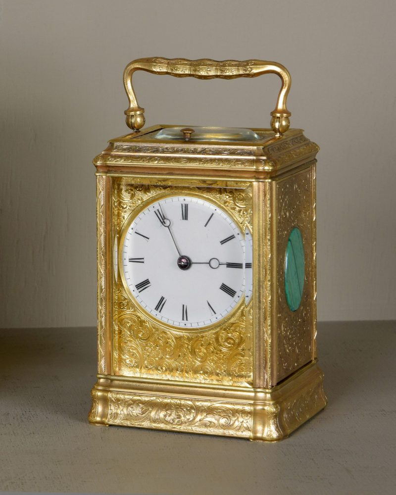 Engraved Carriage clock with Malachite panels, Ca 1870.
